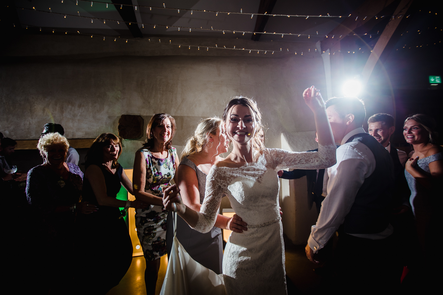 Bride dances a conga with guests following her