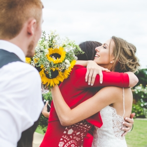 Bride embraces guest