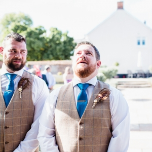 Groom looks up nervously at end of aisle
