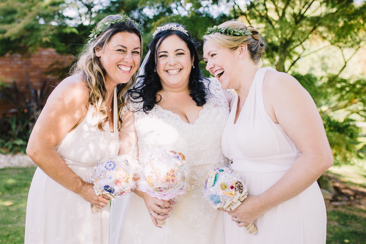 Bride and bridesmaids pose with ornate bouquets