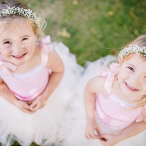 Flower girls look up to camera