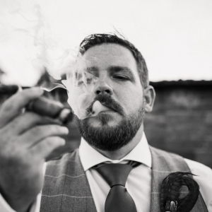 Groom enjoys a cigar