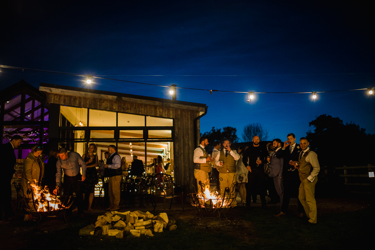 Guests enjoy drinks and marshmellows at the fire pits