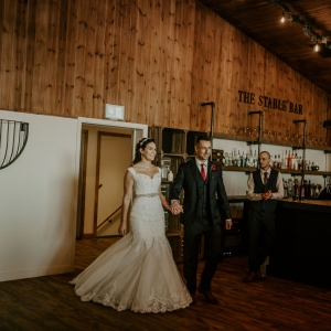 Bride and groom enter the stable barn reception