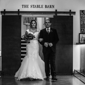 Bride and her father walk into the Press Bar