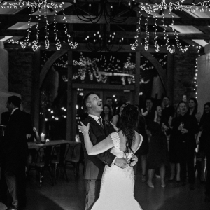 Happy couple laugh in the dancefloor during first dance