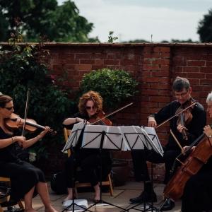 String quartet play in the walled garden