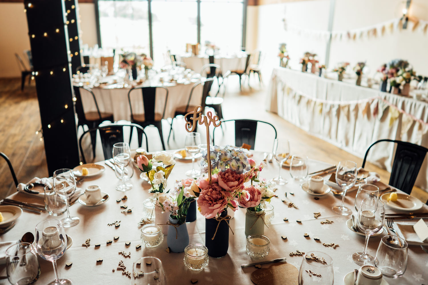 Decorated wedding breakfast tables