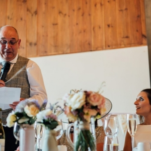 Brides father reads his speech