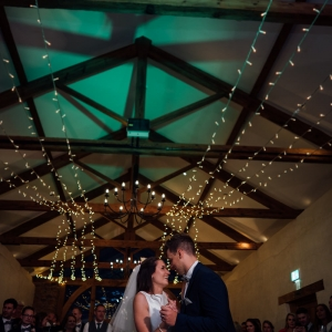 Coupel dance under the lights of the cider barn