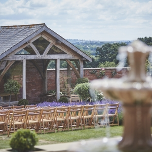 The Arbour in the Walled garden at Upton Barn woth bubbling fountain in the foreground