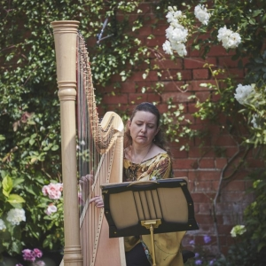 Harpest plays in the Walled Garden at Upton barn Wedding Venue