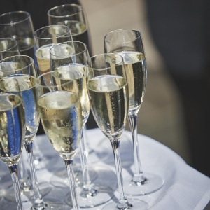 Close Up of Champgnes glasses on tray being served