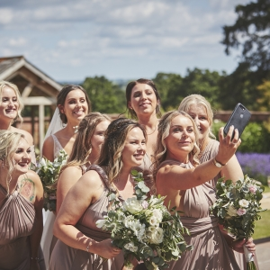 Group of bridesmaid take a selfie in the Walled Garden at Upton Barn