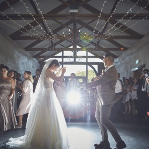 Bride and Grooms first dance in the Cider Barn in front of Guests at Upton Barn