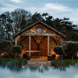Upton Barn Arbour in the rain and lit inside