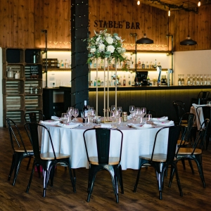 The Stable Barn Wedding Breakfast tables set up in front of the The Stable Bar