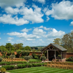 Upton Barn and Walled Garden Arbour with seating for a wedding set out