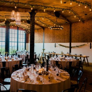 The Stable Barn set up for a Wedding Breakfast with many lights