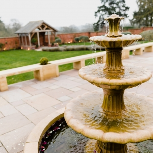 Close up of the fountain in the Walled Garden with uplighters by the walls