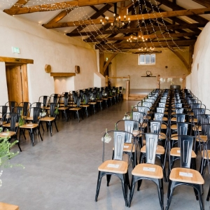 The Cider Barn set up for a wedding ceremony at Upton