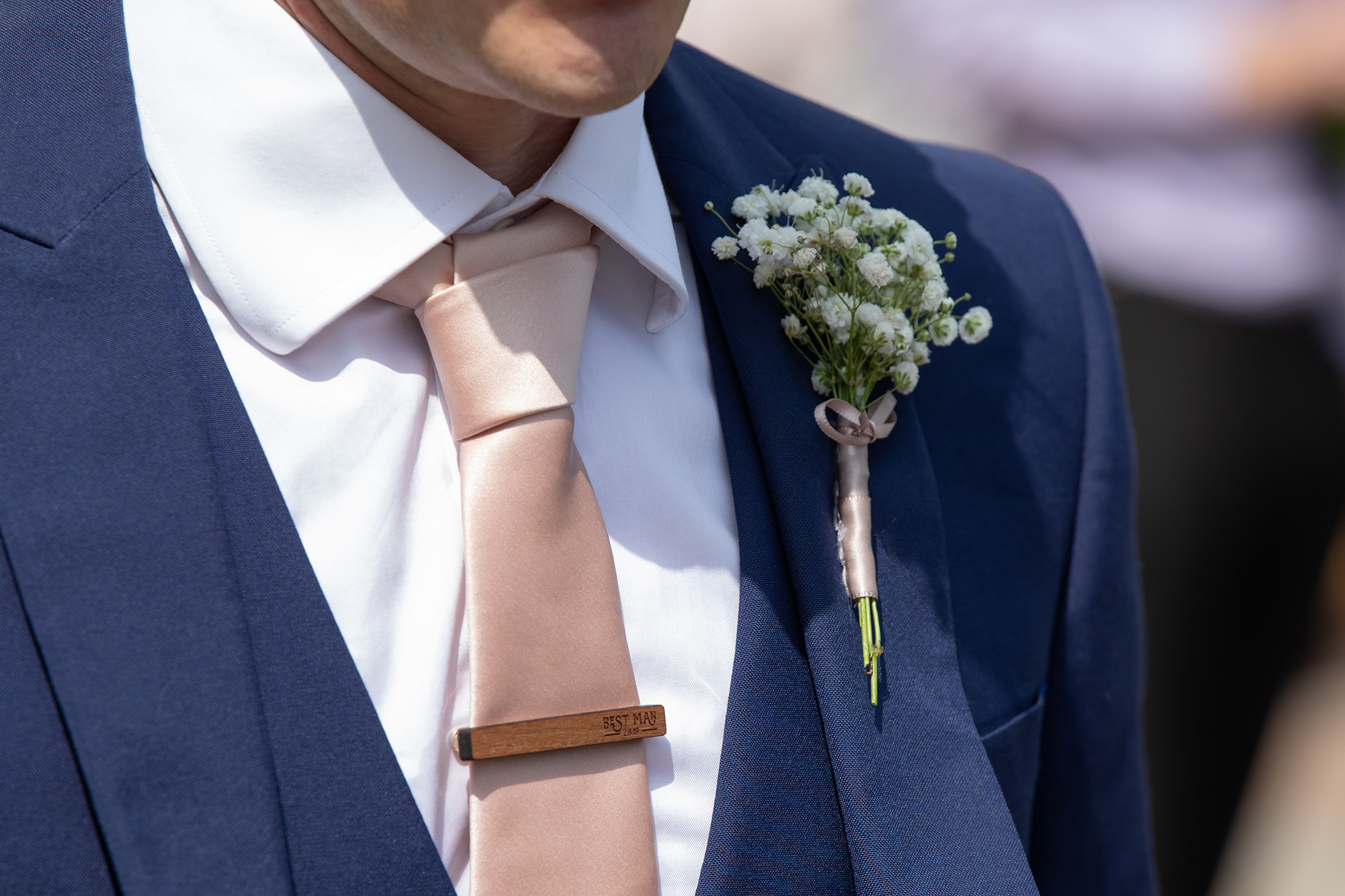 Close up of Best Mans tie pin