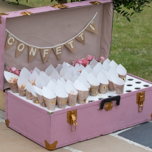 Suitcase of confetti cones all ready to be thrown