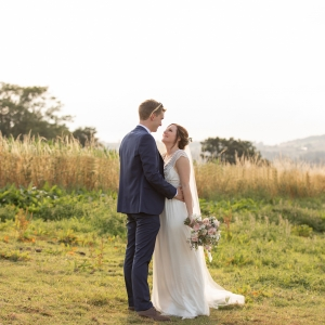 Bride and Groom look in each others eye with a Devon vista in the background