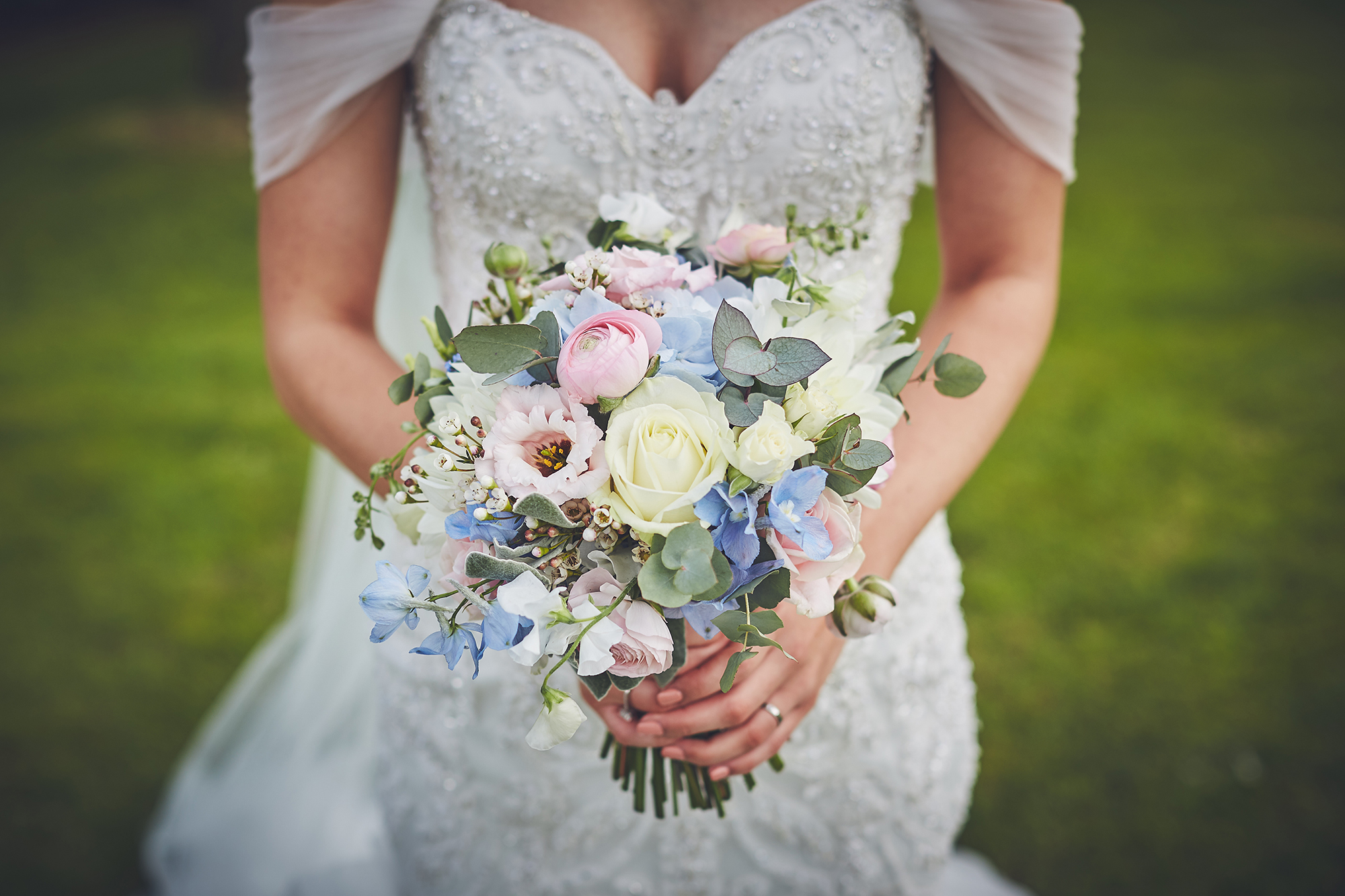 Close up of Brides pale blue and pink bouquet