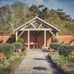The abour at Upton Barn & Walled Garden with seating ready for wedding layed out