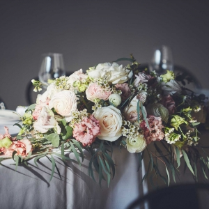 Close up of top table flowers of pale pinks and creams