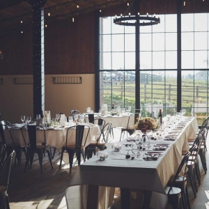 Large window in The Stable Barn bathes the wedding breakfast tables in light