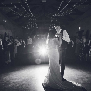 Bride and groom perform first dance infront of guests in the Cider Barn at Upton Barn Wedding Venue