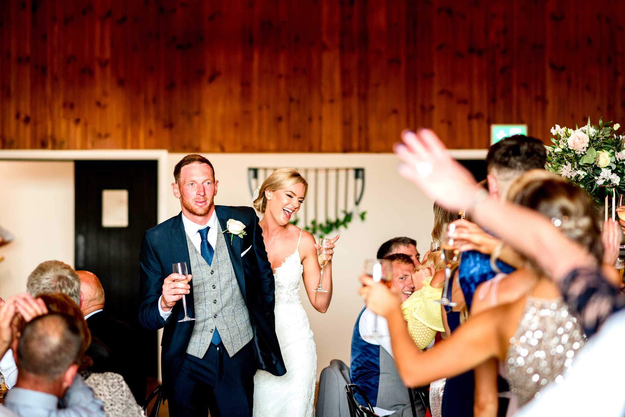 Bride and Groom make their way through The Stable barn to the wedding breakfast