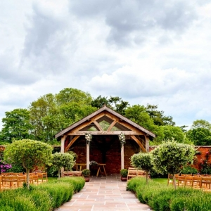 The Arbour adorned with flowers and lush greenery in the Walled Garden at Upton Barn