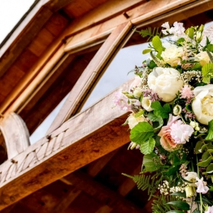 Close up of floral arrangements on the Arbour at Upton Barn