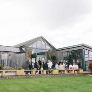 Guest mingle on the patio at infront of The Cider Barn and Press Bar at Upton Barn