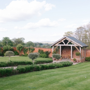 Upton Barn and Walled Garden Arbour in daytime