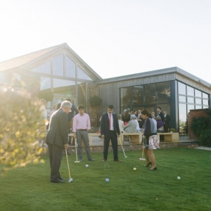 Guests play croquet on the lawn in the Walled Garden at Upton Barn