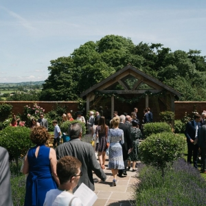 Guest take their seats in the Walled Garden at Upton before the wedding ceremony