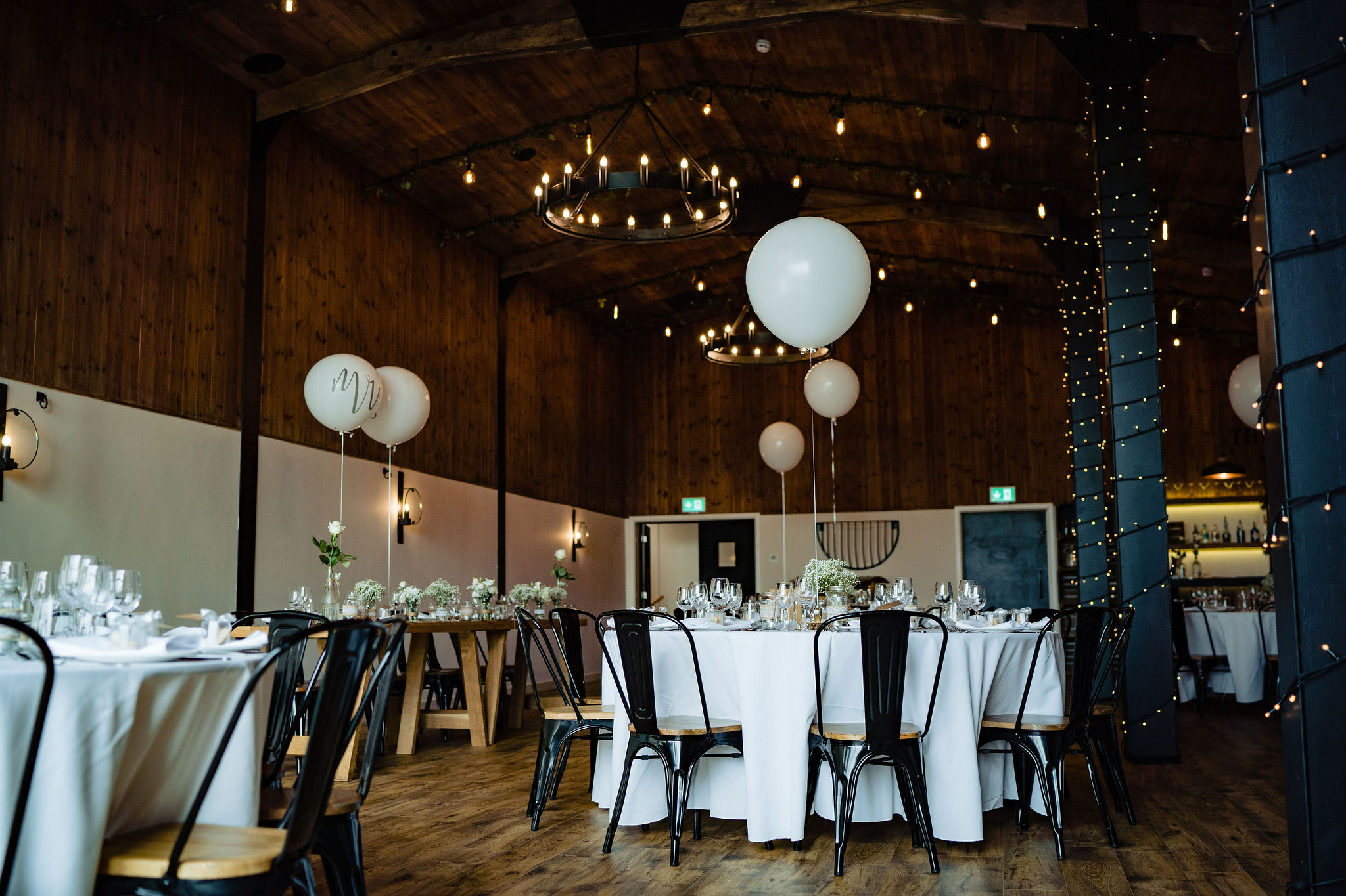Stable Barn at Upton Barn & Walled Grden dressed for a Wedding Breakfast with white oversized balloons