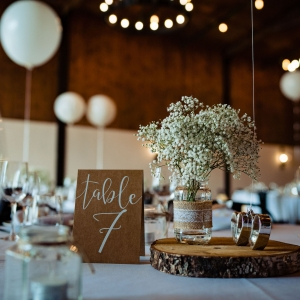 Close up of Wedding Breakfast table number with Gypsophelia