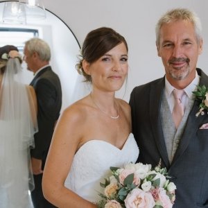 Bride and Her Father pose in ethe Tack Room at Upton Ban