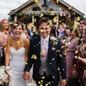 Bride and Groom in a blizzard of flower confetti