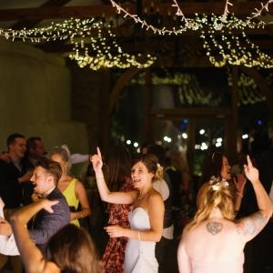 Bride, Groom and Wedding gusets enjoy the last few tracks