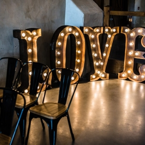 """Love"" wedding lights in the Cider Barn at Upton"
