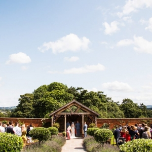 Bride and Groom exchange vows in The Walled Garden at Upton Barn