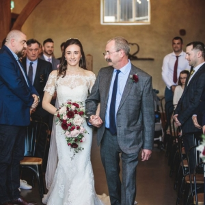 Fathers last glance at his daughter as he walks her down the aisle of The Cider Barn