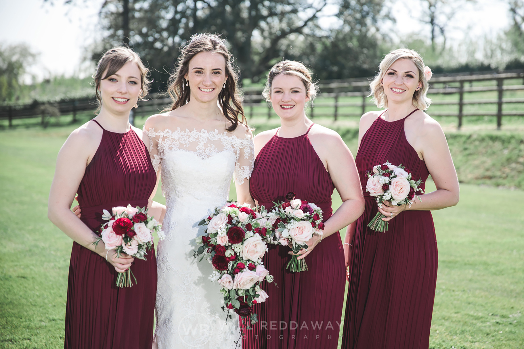 Bride and her maids holding their wedding flowers