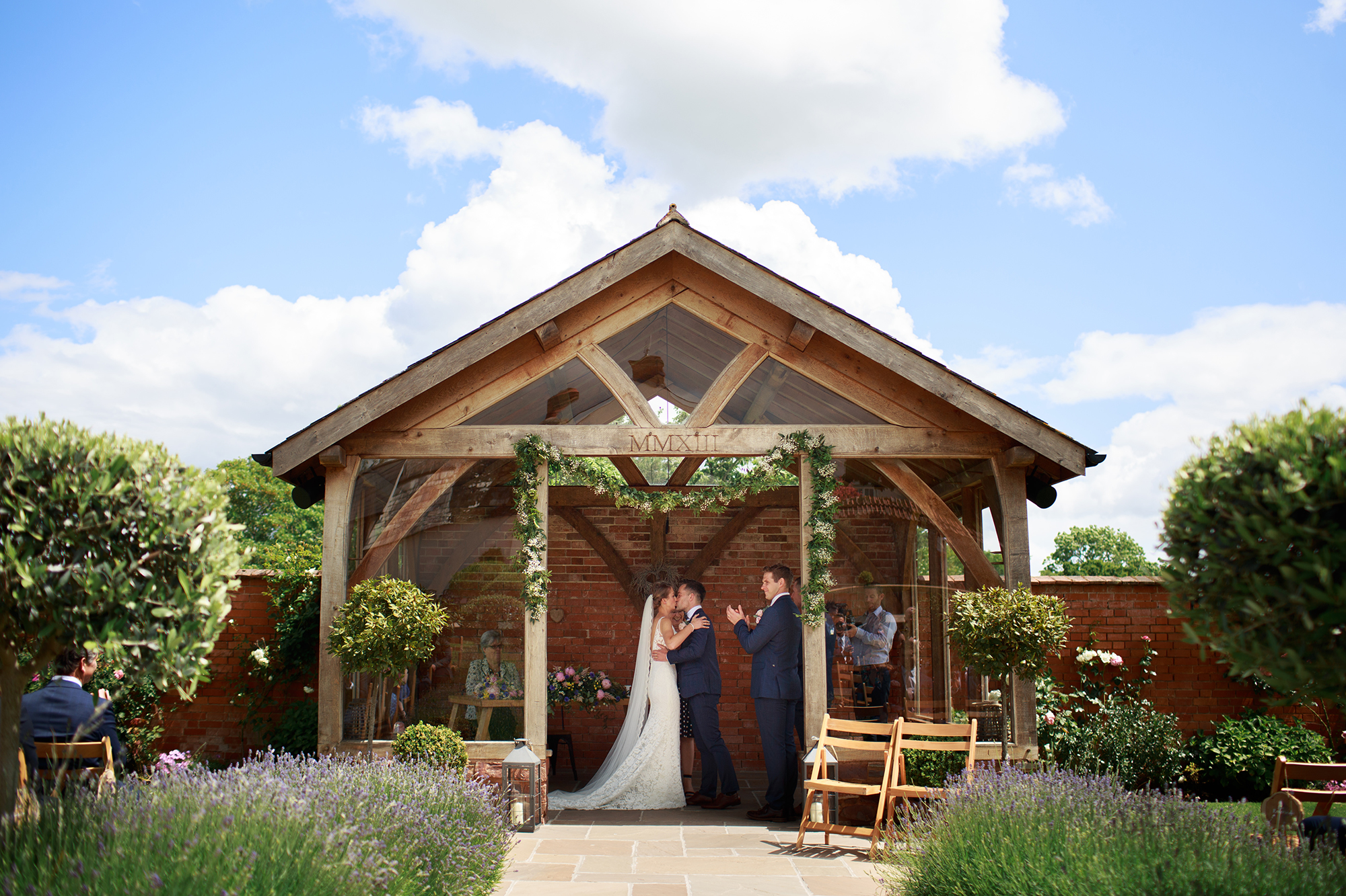 Bride and Grooms first married kiss in the Arbour